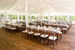 Farm tables under pole tent with liner